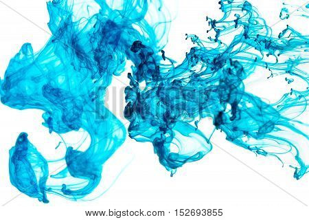 Abstract pattern falling into the water drop of blue ink