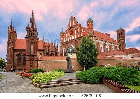 Brick gothic St. Anne's church and Bernardine church in the Old Town of Vilnius UNESCO World Heritage site Lithuania on sunset
