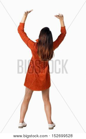 back view of woman pushes wall. Isolated over white background. Rear view people collection. backside view of person. Brunette in elegant red dress holding something over his head.