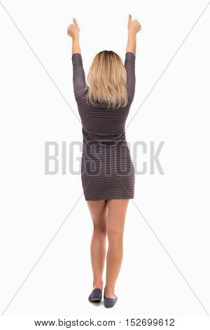 Back view of  woman thumbs up. Rear view people collection. backside view of person. Isolated over white background.