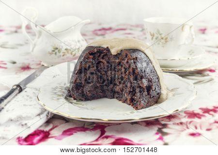 Australien Plum Pudding with Vanilla Rum Sauce on Plate