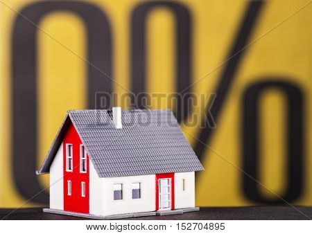 House with a percent sign in the background