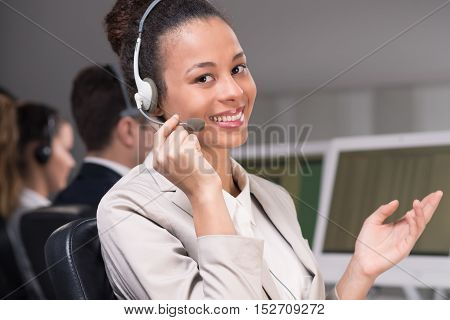 Cropped shot of a smiling elegant businesswoman wearing a headset