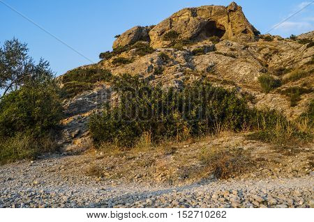 lone rock in the summer evening on a background of blue sky