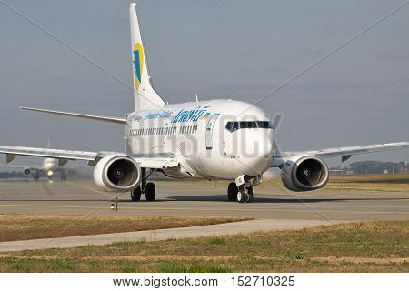 Borispol Ukraine - October 23 2011: Boeing 737 is taxiing along the taxiway to the runway