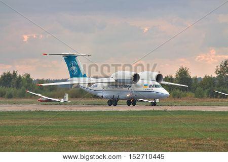 Kiev Region Ukraine - October 3 2010: Antonov An-74 cargo plane is taking off on stormy sunset