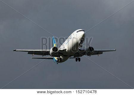 Borispol Ukraine - September 3 2010: Ukraine International Airlines Boeing 737 landing with stormy sky on the background