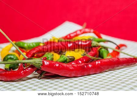 Close-up Of Red And Yellow Peppers On Napkin
