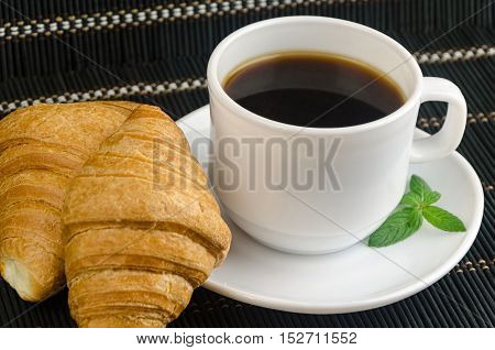 Fresh Cup Of Hot Black Coffee With Croissants