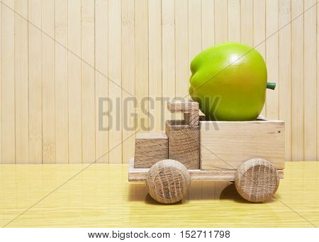 Toy Wooden Car With Green Apple