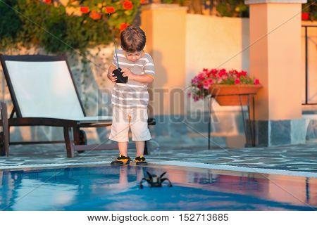 Cute Boy Playing With Remote Control Boat