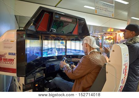 AMSTERDAM, NETHERLANDS - CIRCA NOVEMBER, 2015: a man playing game at Amsterdam Airport. Amsterdam Airport Schiphol is the main international airport of the Netherlands.
