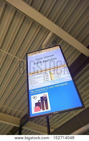 AMSTERDAM, NETHERLANDS - CIRCA NOVEMBER, 2015: gate monitor at Amsterdam Airport. Amsterdam Airport Schiphol is the main international airport of the Netherlands.