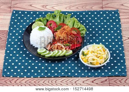 Jasmine rice with spicy fried chicken salad (Khao Yum Kai Zap in Thai) served mixed vegetables salad.