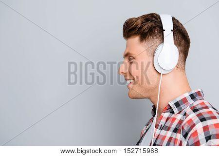 Side View Portrait Of Handsome Smiling Man In Headphones