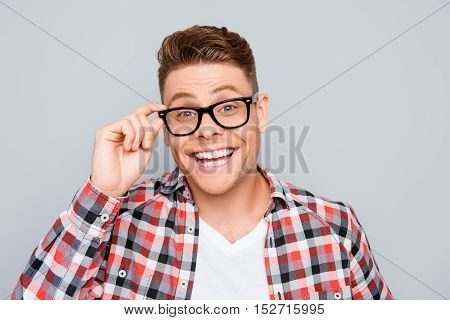 Happy Man With Beaming Smile Touching His Glasses