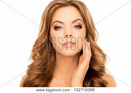 Portrait Of  Pretty Woman  Applying Cream On Her Face