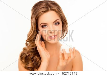 Young Beautiful Woman Applying Cream On Her Face
