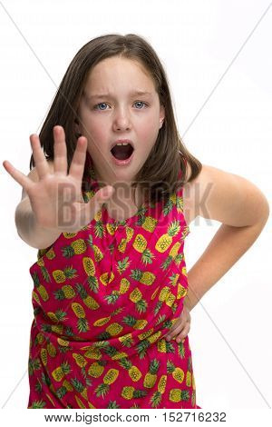A young girl holding up her hand and saying stop!