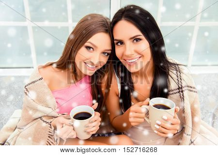 Portrait Of Happy Beautiful Women With Plaid Holding Hot Coffee On Xmas Morning