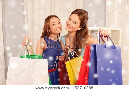 Portrait Of Two Happy Girls With Shopping Packs Before Xmas