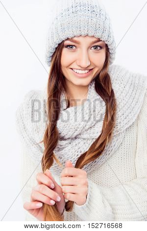 Cheerful Woman  In Warm Hat And Scarf Holding Her Hair