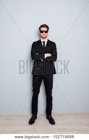 Full Portrait Of Serious Businessman In Black Tuxedo And Glasses