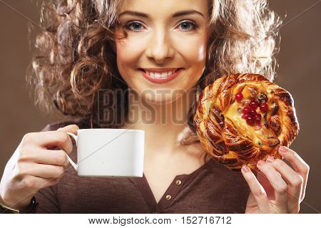 young curly woman with coffee and cake