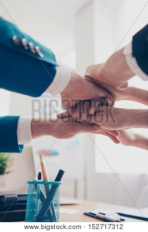 Close Up Of Business People Putting Their Hands On Top Of Each Other