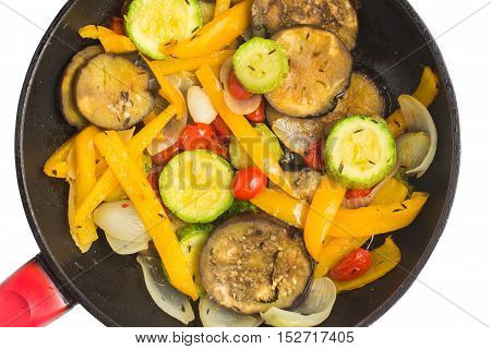 Ratatouille. Aubergine Zucchini and Bell Pepper into a pan. Roasted vegetables