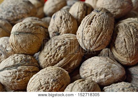 Macro detail of a heap of nuts (walnuts) as a symbol of healthy snack and organic food