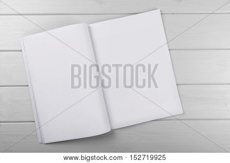 blank white magazine on wooden plank table