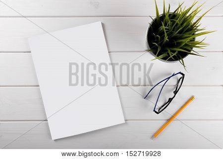 mockup with blank magazine cover on white wooden table