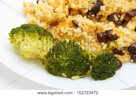 Boiled Rice With Raisins On White Plate