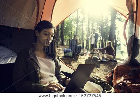 Woman Using Laptop Traveling Destination Camping Concept