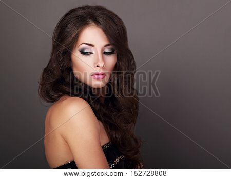 Beautiful Bright Makeup Woman With Curly Long Hair Style And Pink Lipstick Looking Down On Empty Cop