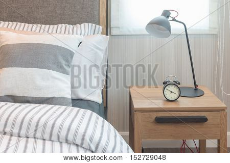 Set Of Pillows And Blanket On Bed In Modern Bedroom
