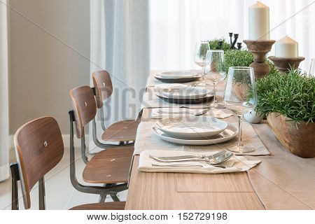 Vase Of Plant On Wooden Table  In Modern Dinning Room