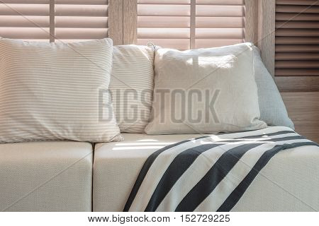 White Color Set Of Pillows And Sofa In Modern Living Room