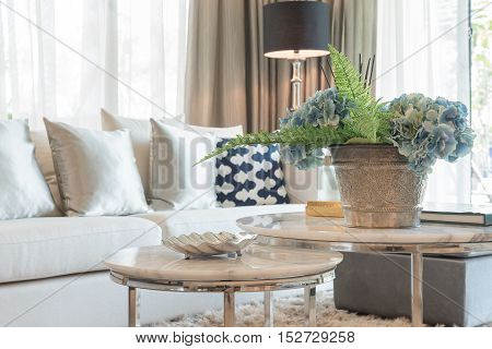 Vase Of Plant On Round Table In Classic Living Room
