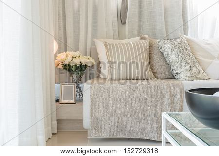 Set Of Pillows On Grey Sofa In Modern Living Room