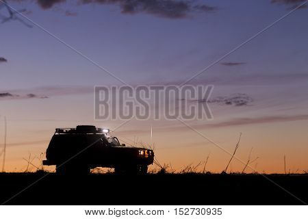 Suv Silhouette On Sunset Sky Background