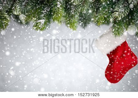 Christmas tree with stocking in snow