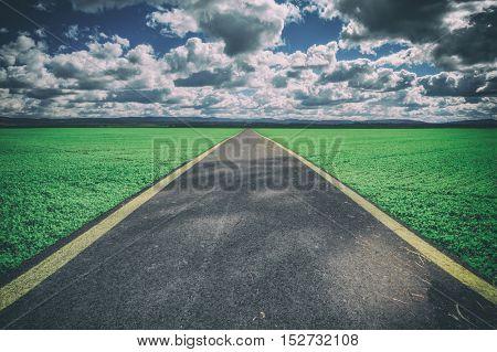 road in summer field closeup, toned like Instagram filter