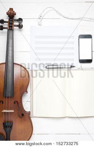 keyboard computer with notebook smartphone and violin on white background
