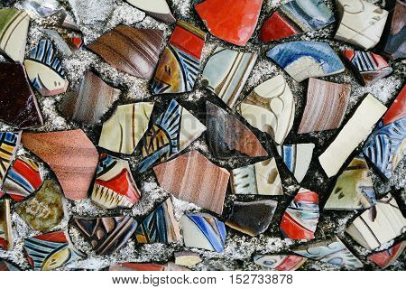 Okinawa Japan - October 21 2016: Cracked Ceramics pottery adapted to decorate on the wall