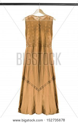 Ethnic lacy yellow dress on wooden clothes rack isolated over white