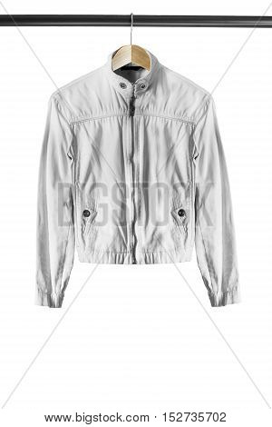 White denim jacket on wooden clothes rack isolated over white