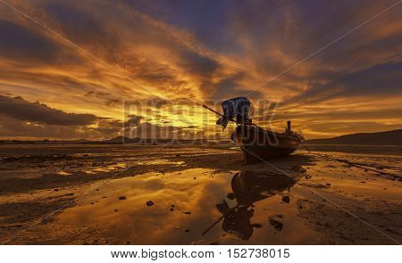 Fishing boats at low tide in the morning light warm quiet very beautiful.