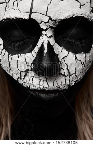 Beauty Woman with Skull on her Face. Halloween Makeup Concept